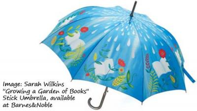 photo of an umbrella with books surrounded by flowers and rain