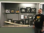 Photo of Tim Gross standing with his art display.