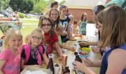 Summer Reading volunteers serve ice cream at the program kick-off in Rensselaer.