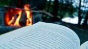 book with campfire in background