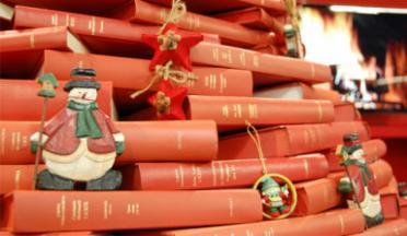 Close up photo of Christmas tree made of books