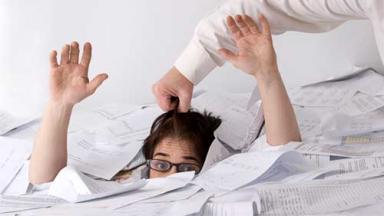 man trying to lift a person out of a large pile of paper sheets