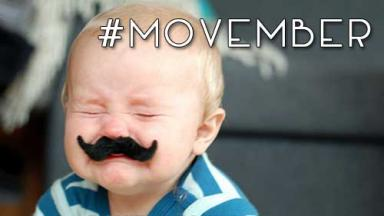 Baby with fake mustache. Hashtag Movember.